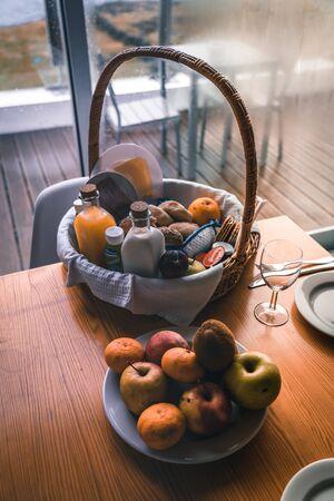 Composition of picnic basket, baguettes, grapes, bottle of wine, jam jars. Photo taken in Azores, Portugal.