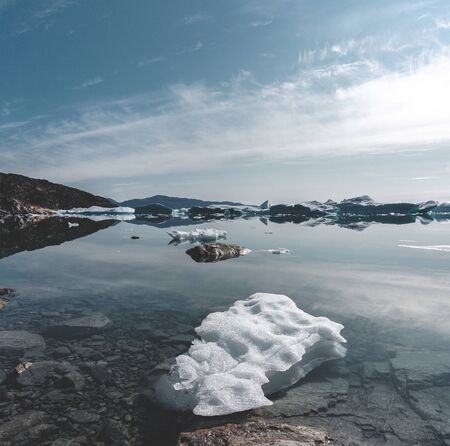 Beautifull landscape with floating icebergs in glacier lagoon and lake in Greenland. Ilulissat Icefjord Glacier. Iceberg and ice from glacier in arctic nature landscape.