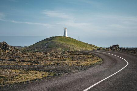 Gunnuhver, Reykjanes peninsula. Geothermal area with Reykjanesviti or Reykjanes lighthouse, the oldest. Powerful caldara of Gunnuhver, in the background.