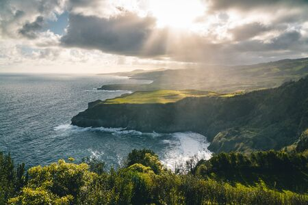 Epic scenic outlook of Miradouro de Santa Iria - north coast of Sao Miguel, largest island of Azores archipelago during sunset with dramatic sky and clouds. Photo taken in Azores, Portugal. 版權商用圖片