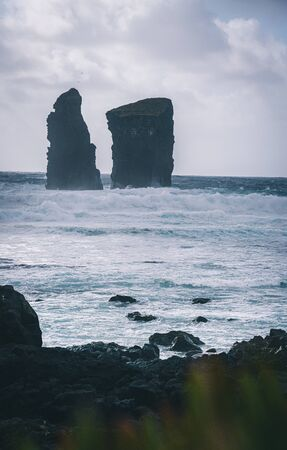 Aerial picture of wild rock formations in the middle of the open atlantic ocean next to Mosteiros, in Sao Miguel island, Azores, Portugal. Photo taken in Azores, Portugal.