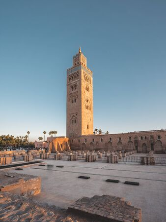 Koutoubia Mosque minaret during twilight located at medina quarter of Marrakesh, Morocco, North Africa. Sunset view on a sunny day with blue sky.