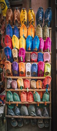 Colorful handmade leather slippers babouches on a market souk in the medina of Marrakech, Morocco. Photo taken in Morocco.