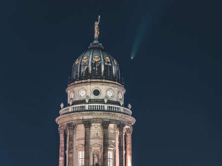 Neowise Comet visible in city of Berlin over Berlin Cathedral with illuminated night sky. Astro photo during night time with stars. Capital of Germany.