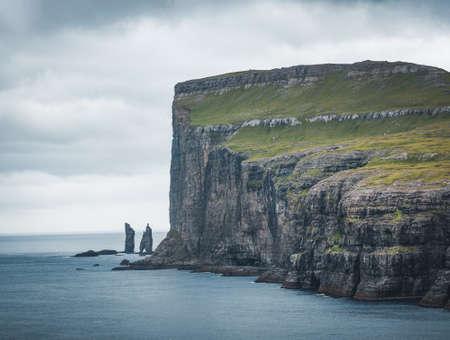 Risin and Kellingin rocks in the sea as seen from Tijornuvik bay on Streymoy on the Faroe Islands, Denmark, Europe