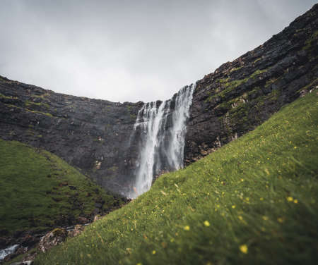 Aerial view of the Fossa Waterfall on island Bordoy. This is the highest waterfall in the Faroe Islands, situated in wild scandinavian scenery. Banco de Imagens