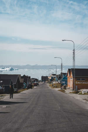 August 18 2019, Ilulissat, Greenland. Panoramic view across the main street of Ilulissat, located on the westcoast of Greenland.
