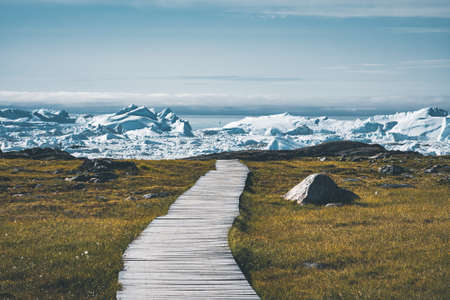 View towards Icefjord in Ilulissat. Easy hiking route to the famous Kangia glacier near Ilulissat in Greenland. The Ilulissat Icefjord seen from the viewpoint. Banco de Imagens
