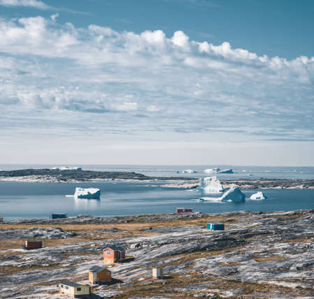 The colorful house of Rodebay Ilulissat, Greenland. This settlement is located on a small peninsula jutting off the mainland into eastern Disko Bay, 22.5 km north of Ilulissat