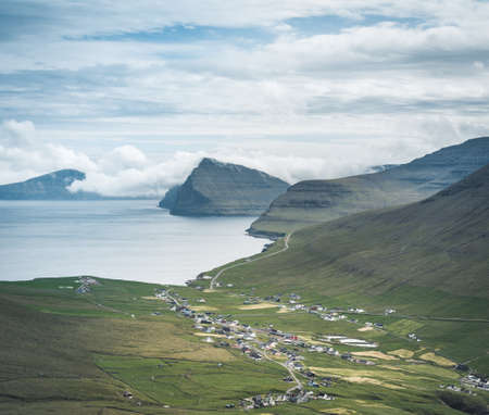 Faroe Islands Panoramic view from Kap Enniberg to the small village Vidareidi, its fjords, Kunoy island and mountains