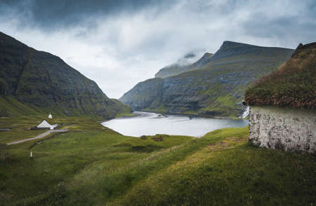 The old Lutheran church in Saksun village with view over the saksun falley on the island of Streymoy, Faroe Islands, Denmark Banco de Imagens