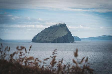 Dramatic view of Koltur island in Atlantic ocean. Faroe Islands, Denmark. Landscape photography. Nordic Natural Landscape. Banco de Imagens