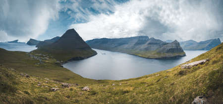 Faroe Islands Panoramic view from Kap Enniberg to the small village Vidareidi, its fjords, Kunoy island and mountains. Photo taken in Faroe Islands.