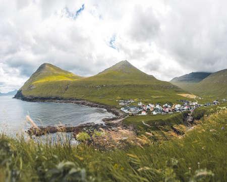 Faroe islands village of Gjogv or Gjov in Danish. Sea-filled gorge on the northeast tip of the island of Eysturoy, in the Faroe Islands.