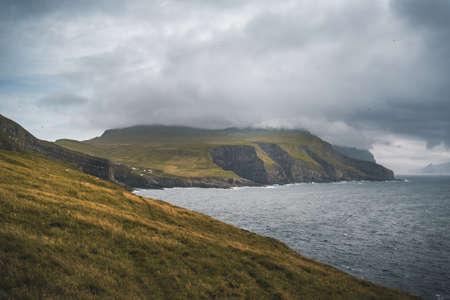 Beautiful Mykines Island with green grass landscapes and Atlantic Ocean. Mykines island, Faroe Islands, Europe.