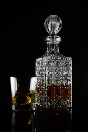 whiskey in a bottle with glass Banco de Imagens