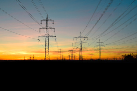 electric tower in the sunrise