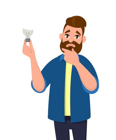 Man is holding broken bulbdamaged bulb. Feeling sad. No idea. Broken light bulb.