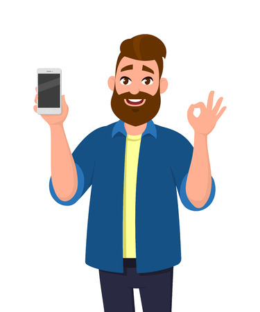 Happy young man showing smartphone and showing okay, OK or O sign. Mobile phone technology concept. Vector illustration in cartoon style. Ilustracja