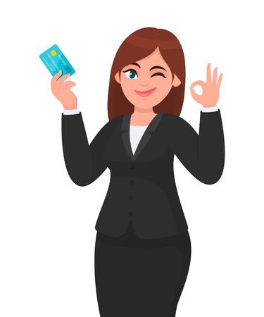 Femme d'affaires professionnelle montrant/détenant une carte bancaire de crédit/débit/ATM et gesticulant/fait signe d'accord/ok, tout en clignant des yeux. Bon, comme, accord, accord, concept positif en dessin animé. Mode de vie moderne. Vecteurs