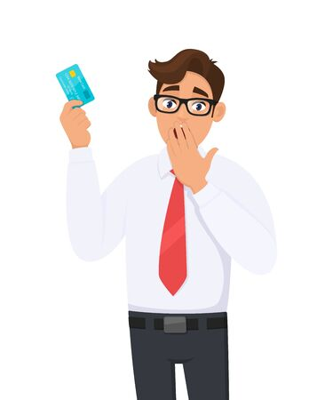 Shocked young businessman showing credit, debit, ATM card and covering his mouth with hand. Person holding digital payment card. Male character design illustration. Modern lifestyle in cartoon.