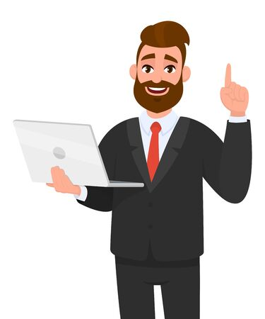Young business man holdingshowing latest brand new laptop computer device and pointing finger up or gesturingshowing number one with hand finger. Modern lifestyle, digital technology trend, gadget.