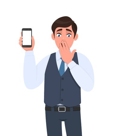 Shocked young man in vest suit showing mobile, cell or smartphone. Frustrated trendy person covering hand on mouth. Male character design illustration. Modern lifestyle concept in vector cartoon. Stock Illustratie