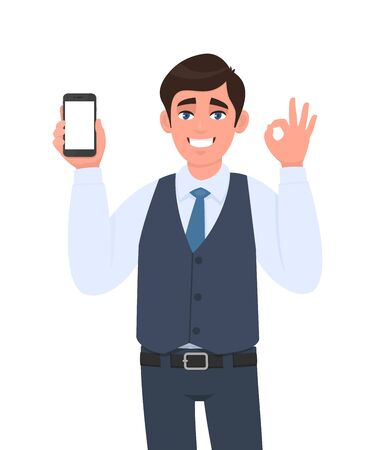Happy young business man in vest suit showing a blank screen mobile phone and gesturing okay, OK sign. Person holding smartphone. Mock up template. Modern technology concept in vector cartoon style. Stock Illustratie