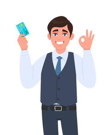 Young businessman showing credit, debit card. Man making or gesturing okay, OK or cool sign. Trendy person in waistcoat holding ATM card. Stylish male character illustration in vector cartoon style.