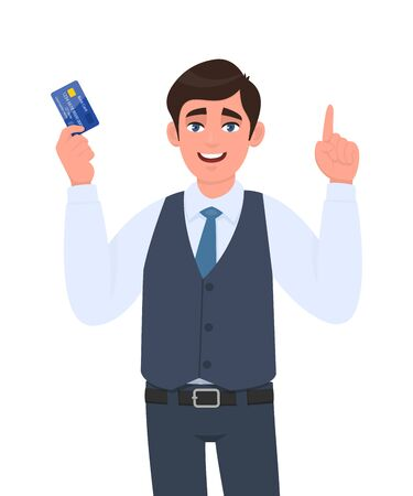 Young businessman showing credit, debit card. Man pointing or gesturing finger up. Trendy person in waistcoat holding ATM card. Idea, solution. Stylish male character illustration in vector cartoon.