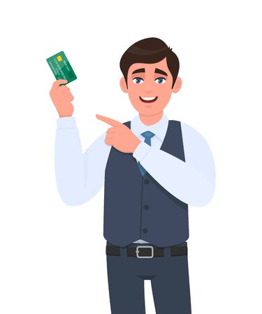 Young business man showing credit, debit card and pointing finger hand. Trendy person in waistcoat holding ATM card. Stylish male character illustration. Modern lifestyle design in vector cartoon.