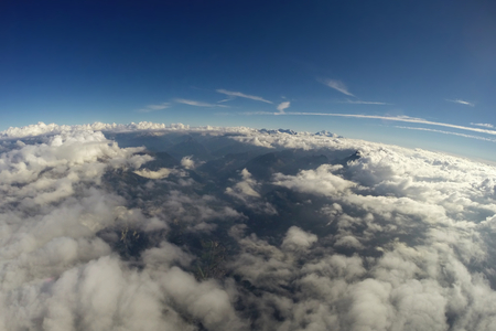 skydive: Aerial View - Alps, Clouds and Blue Sky - 4500m