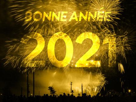 Bonne annee 2021 card on a golden fireworks background