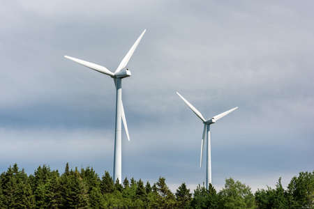 Close-up of two white wind turbines