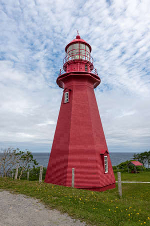 Full view of the La Martre red lighthouse in Gaspesie
