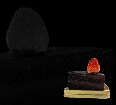 Chocolate cake and Strawberry placed on gloden tray on black background Stock Photo