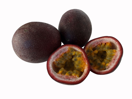 Tropical Fruit. Two whole passion fruit and a cut passion fruit on white background.