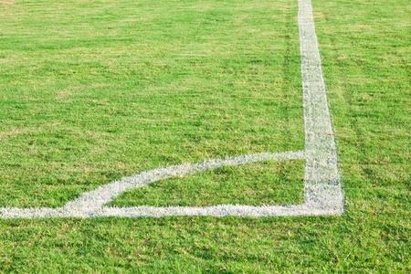 Green corner of football ( soccer ) field photo