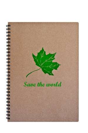 Save the world word on brown notebook with green leaf, isolated on white background  photo