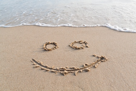 Happy face on sand Stock Photo