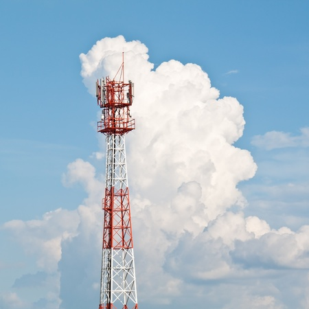 Mobile (cell) phone antenna  in blue sky and white cloud