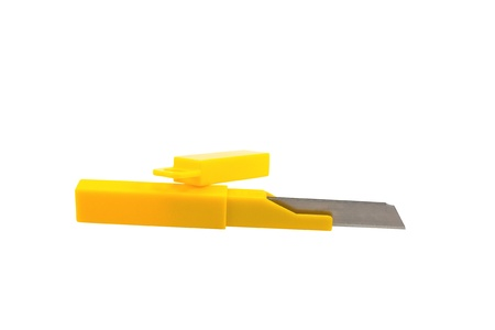 Cutter Blade with yellow box in white background photo