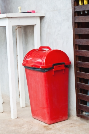 Small Red Garbage Bin ( Trash Can ) Near White Table Stock Photo, Picture  And Royalty Free Image. Image 13603808.