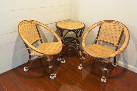 Rattan chairs and table in the room photo