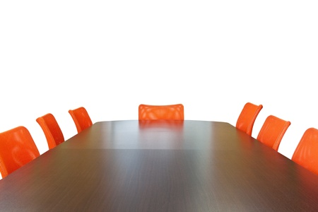 Meeting room with brown table , orange armchairs , television and wood wall Stock Photo