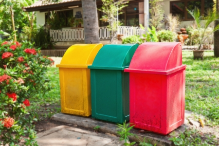 waste disposal: Tree color garbage bins with in front of house