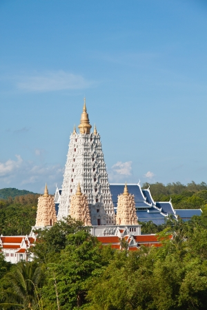 gaya: White Bodh Gaya style pagoda in blue sky Stock Photo