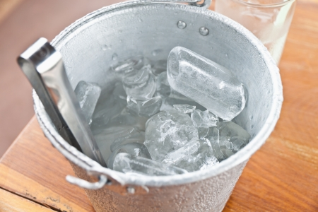Close-up of Ice cubes in tin bucket