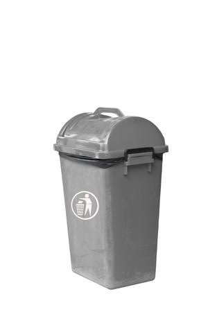 Small grey garbage bin with black garbage bag