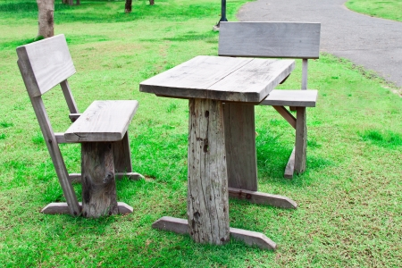 old wooden table and chairs in lawn photo